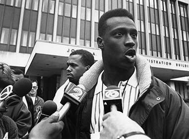 Student in the 1960s is interviewed by media regarding protest at MSU